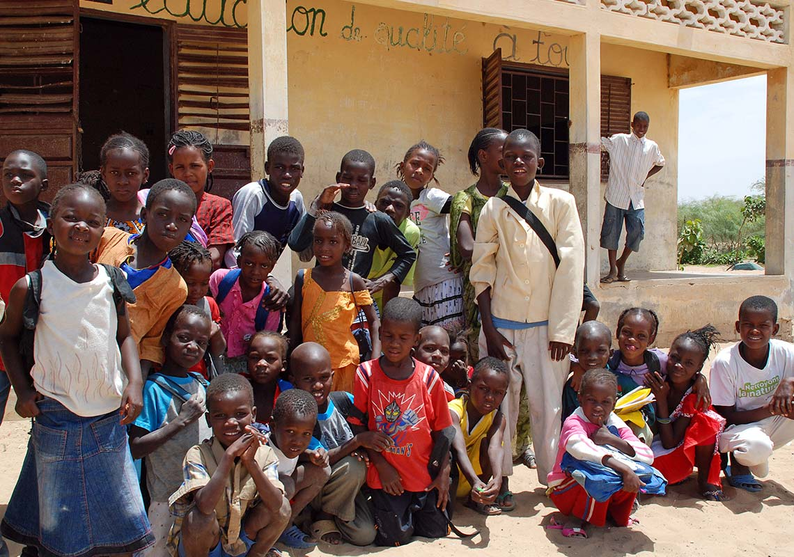 Photograph of children from the Demizine school helped by Barfoots SCL