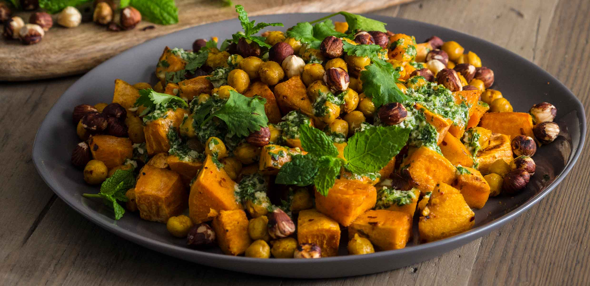 Photograph of Roast sweet potato with roast chickpeas & herby tahini dressing using Sweet Potatoes grown on the Barfoots SCL farm in Senegal