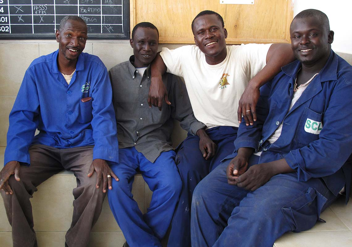Photograph of four members of the Barfoots SCL farm workforce