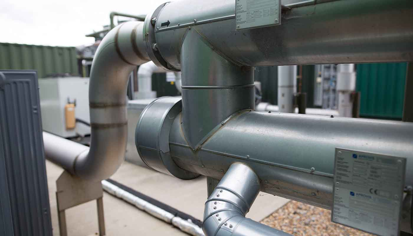 Photograph of pipes that are used to clean the gas produced during the anaerobic digestion process.