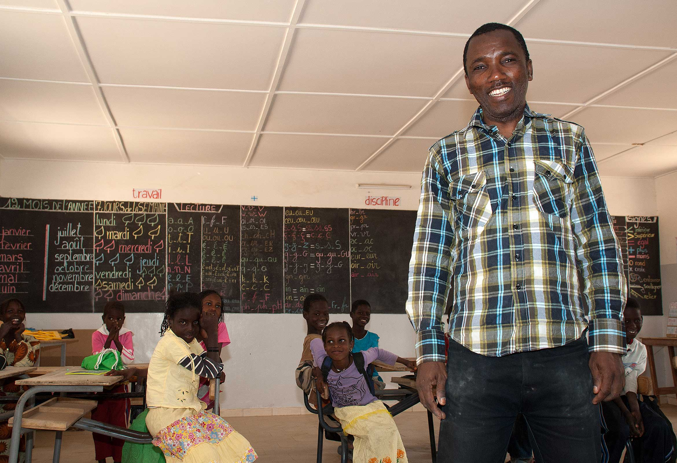 Photograph of a Senegalese teacher helped by the community work by the Barfoots SCL farm in Senegal