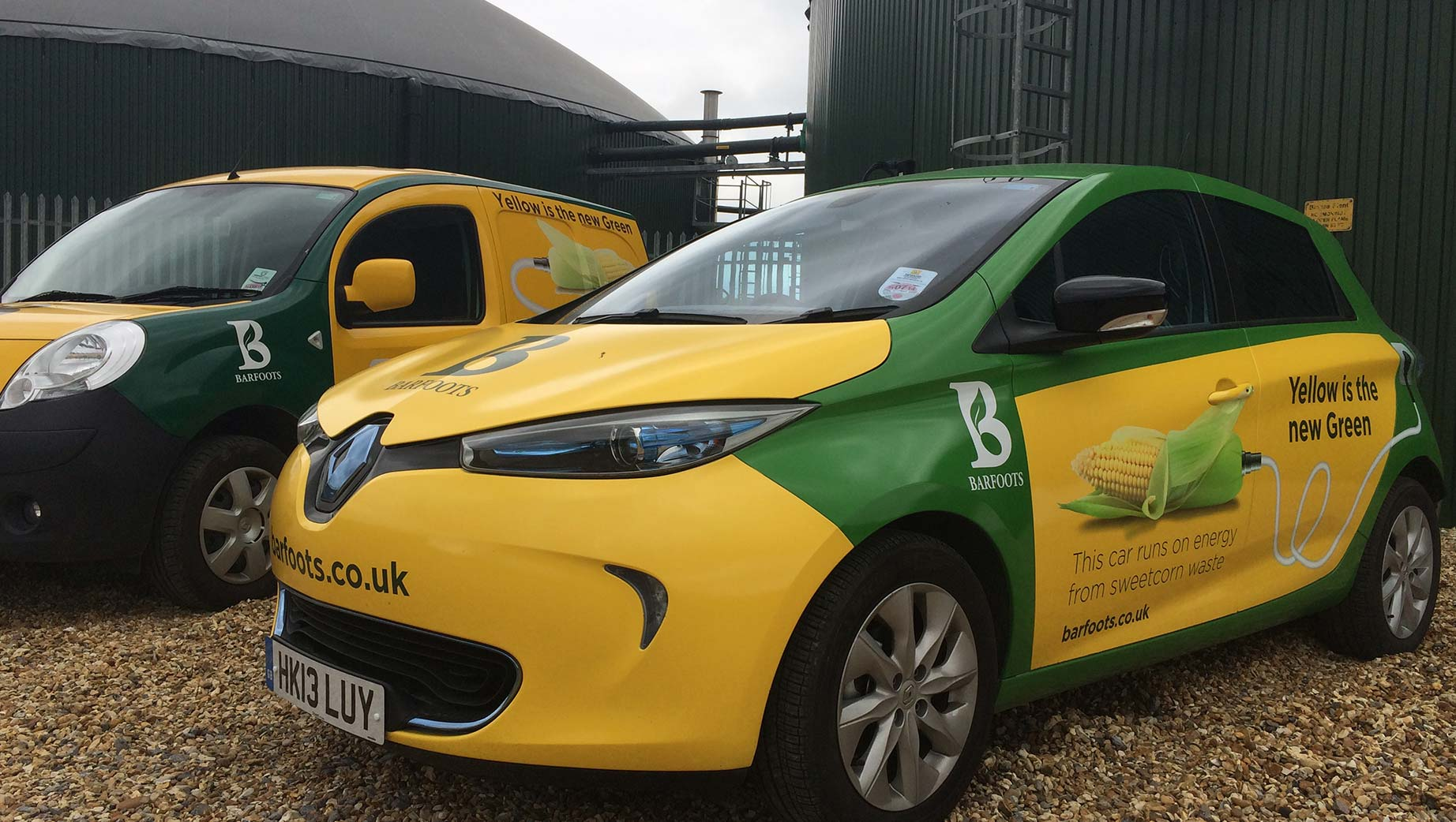 Photograph of two cars that are powered by Barfoots' sweetcorn waste
